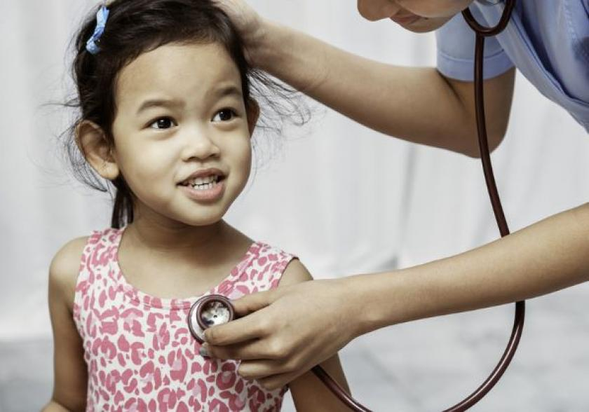 Young girl getting examined with stethoscope by paediatrician