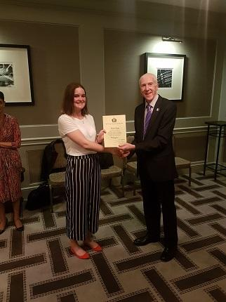 2017 Prize winner Hannah McKay receiving her prize certificate from Dr David Evans